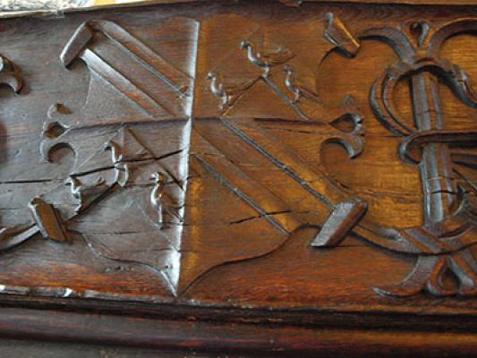 The arms of Kay quartered with those of Fynchden carved in the panelling at Woodsome